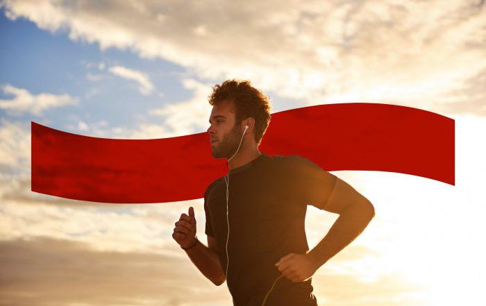 Man jogging with his earphones in.