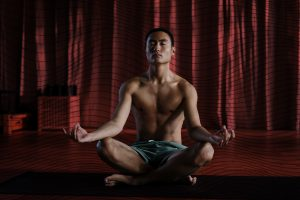 Man meditating in a lotus pose.