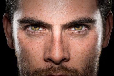 Focused stare of a man with green eyes
