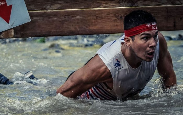 Andrea Cloarec during one of the obstacles at a Spartan Race.