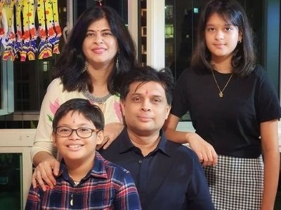 Shubhada B. with her family.