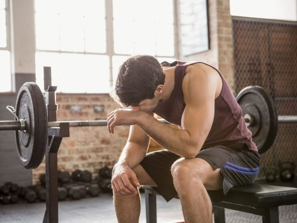 A man rests during a workout.
