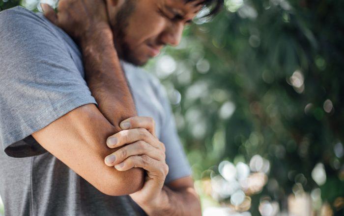 Man feeling pain in elbow