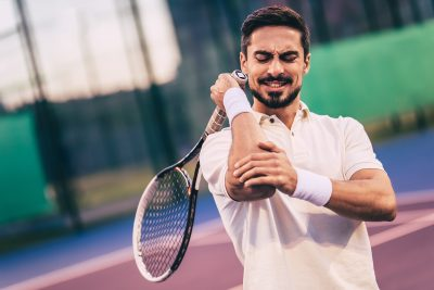 Tennis player experiencing a tennis elbow