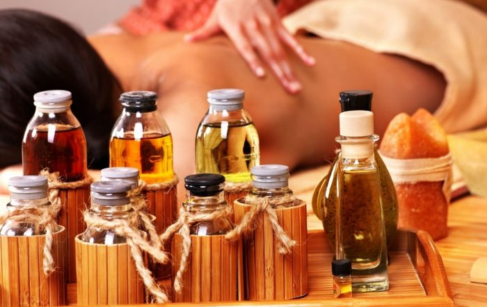 Different types of body massage oils on display.